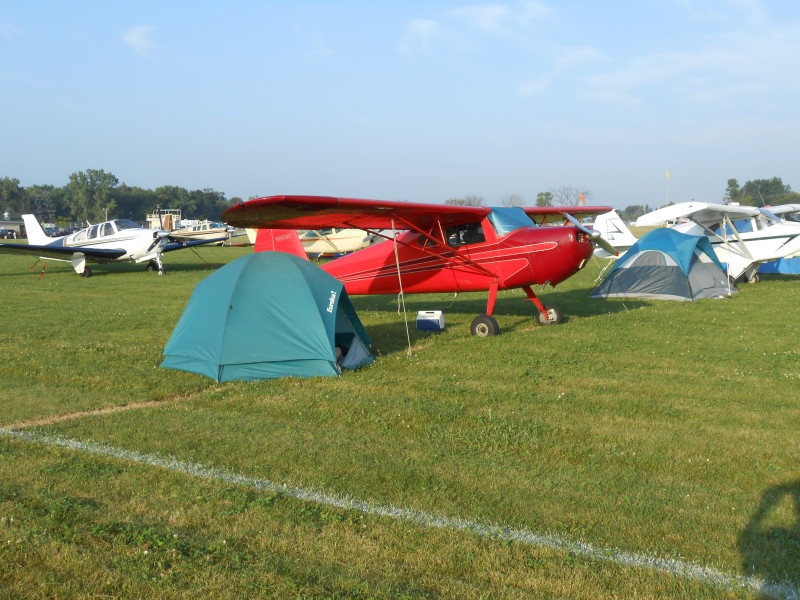 Image of C140 Redbird camping at Oshkosh Fly-In
